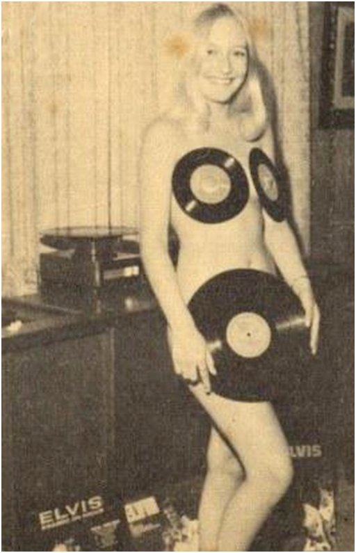 naked elvis fan wearing 45 rpm records on her nipples