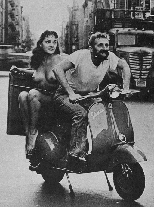 a glamour nude on a vespa scooter