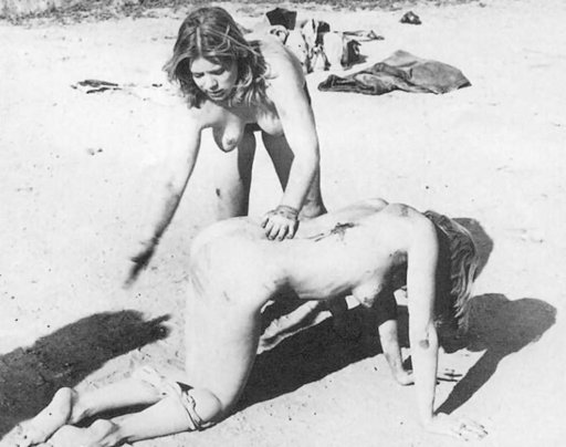 vintage outdoor spanking on the beach