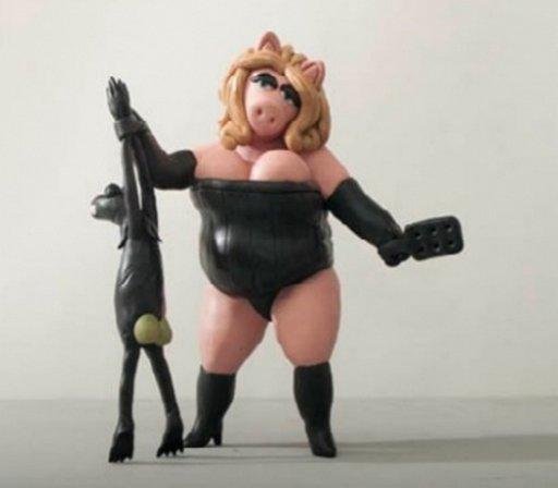 Miss Piggy spanking Kermit