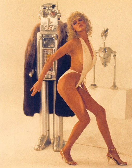 brigitte nielsen almost nude in a white one piece swimsuit while hanging and petting on a robot pimp