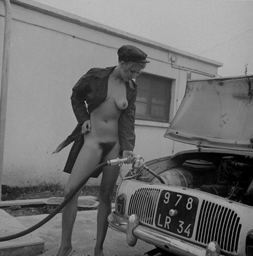 vintage nude gasoline filling station girl pumps gas