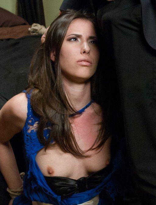 Casey Calvert on her knees and about to suck some dick with her wrists tied