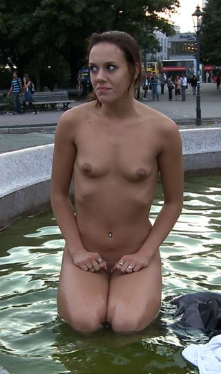 woman washes her clothes nude in a public fountain in Berlin