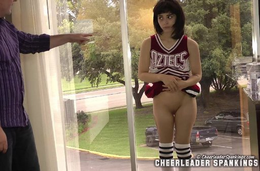 cheer leader showing her spanked bottom to the general public