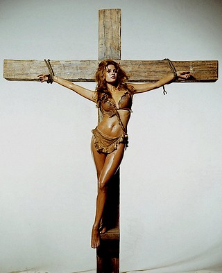 raquel welch tied to a cross with rope