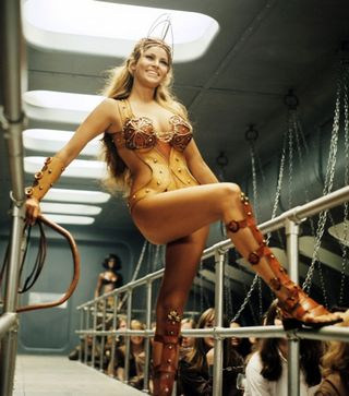 raquel welch as the galley slave whip master on board The Magic Christian