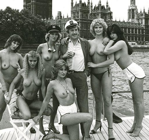Paul Raymond with some of his Soho dancers on a yacht in the Thames