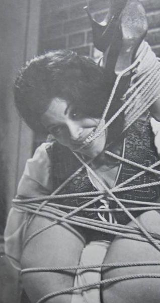 bondage model smiling through her ropes