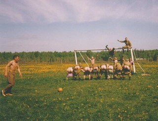 russian army guys mooning the camera during a soccer game
