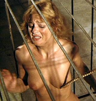 caged naked woman prisoner being molested with a whip