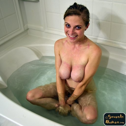 Penny Pax taking a hot bath after her bondage sex shoot, smiling and showing off her rope marks