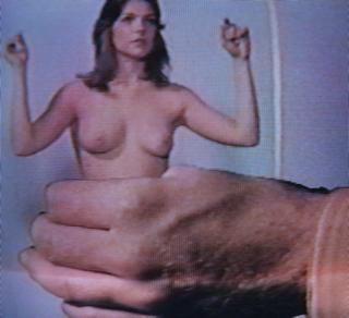shrunken woman in hand