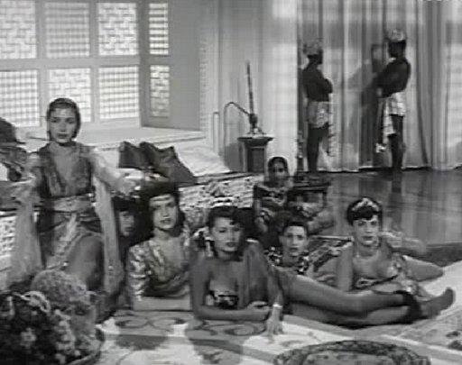 Sophia Loren in a harem scene wearing a floral bikini