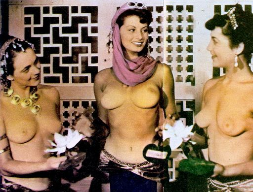 color photo of topless Sophia Loren and costars