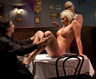 man with a naked woman on his restaurant table