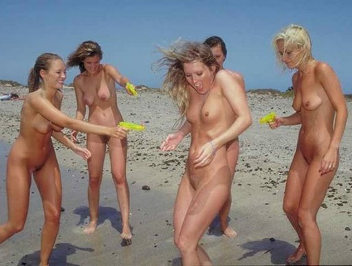 naked blondes have a squirt gun war at a nudist/naturist seaside camp