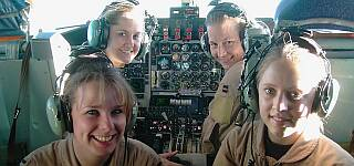 Beautiful young ladies crewing a KC-130 mid-air refueling tanker