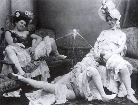 three women supporting a ball on streams of pee