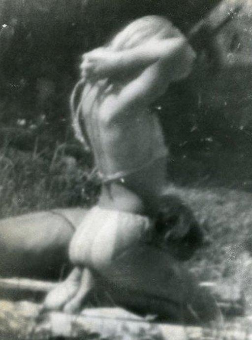 Miroslav Tichý kneeling bikini babe