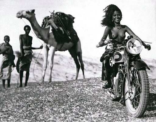 topless female motorcyclist in north africa photo