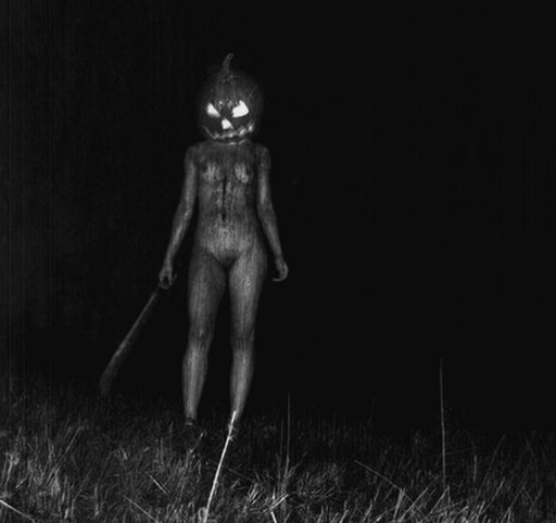 scary halloween nude with a machete and glowing pumpkin head