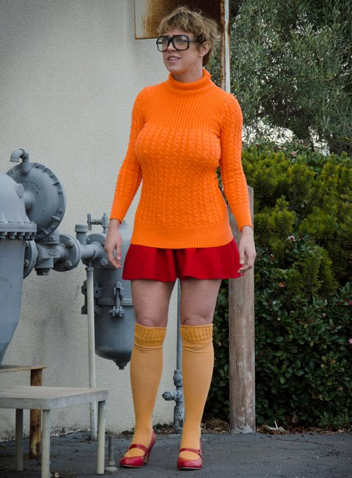 velma getting ready to snoop into an abandoned warehouse