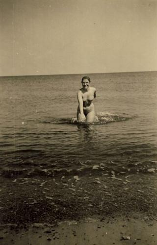 vintage Venus rising from the waves with a smile on her face