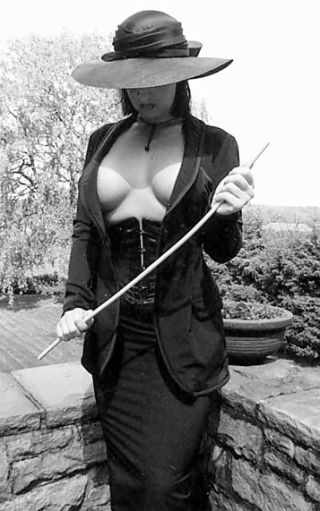 severe mystery woman with cane