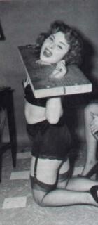 vintage Irving Klaw type model in home made wooden bondage stocks