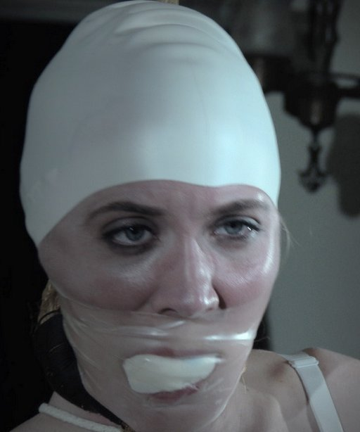 sierra cirque gagged  while wearing a white rubber swim cap