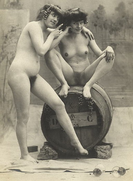 two naked women and a keg of wine