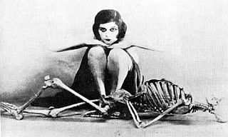 woman sits with skeleton
