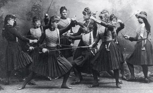 female fencers posing with swords